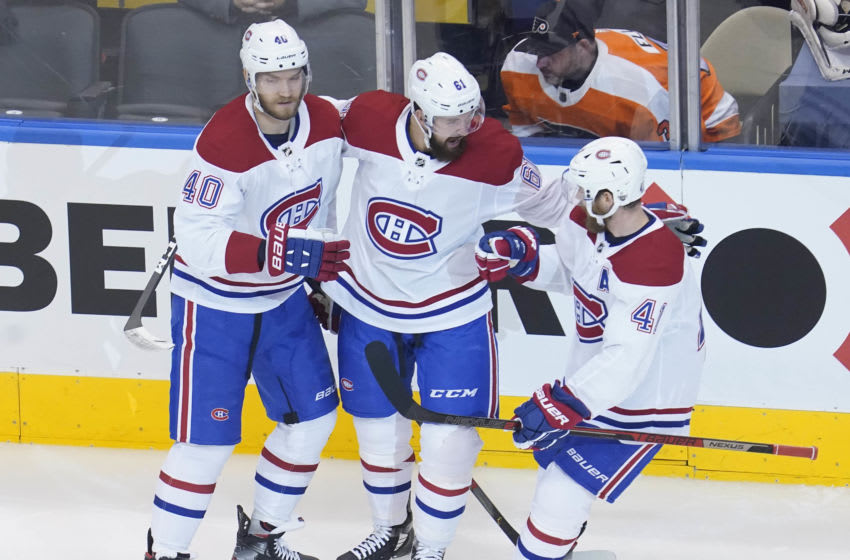 Aug 19, 2020; Toronto, Ontario, CAN; Montreal Canadiens right wing Joel Armia (40) celebrates with defenseman Xavier Ouellet (61) and left wing Paul Byron (41) his shorthanded goal scored against the Philadelphia Flyers during the first period in game five of the first round of the 2020 Stanley Cup Playoffs at Scotiabank Arena. Mandatory Credit: John E. Sokolowski-USA TODAY Sports