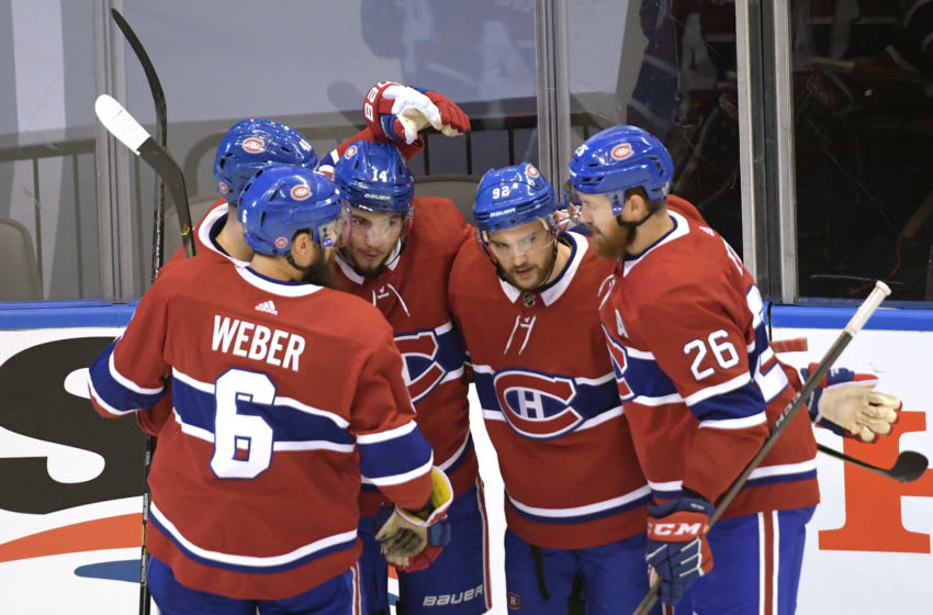 Aug 21, 2020; Toronto, Ontario, CAN; Montreal Canadiens center Nick Suzuki (14) celebrates with right wing Joel Armia (40) and defenseman Shea Weber (6) and left wing Jonathan Drouin (92) and defenseman Jeff Petry (26) after scoring a goal against the Philadelphia Flyers during the first period in game six of the first round of the 2020 Stanley Cup Playoffs at Scotiabank Arena. Mandatory Credit: Dan Hamilton-USA TODAY Sports