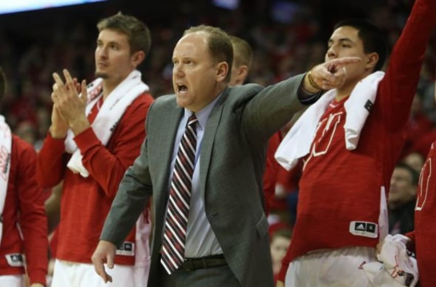 Dec 29, 2015; Madison, WI, USA; Wisconsin Badgers interim coach Greg Gard signals a Wisconsin ball after it was out-of-bounds during the game with the Purdue Boilermakers at the Kohl Center. Purdue defeated Wisconsin 61-55. Mandatory Credit: Mary Langenfeld-USA TODAY Sports