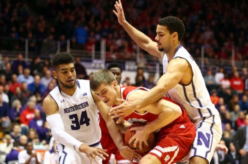Jan 12, 2016; Evanston, IL, USA; Wisconsin Badgers forward Aaron Moesch (bottom) is defended by Northwestern Wildcats guard Sanjay Lumpkin (34) and Northwestern Wildcats forward Joey van Zegeren (right) during the first half of the game at Welsh-Ryan Arena. Mandatory Credit: Caylor Arnold-USA TODAY Sports