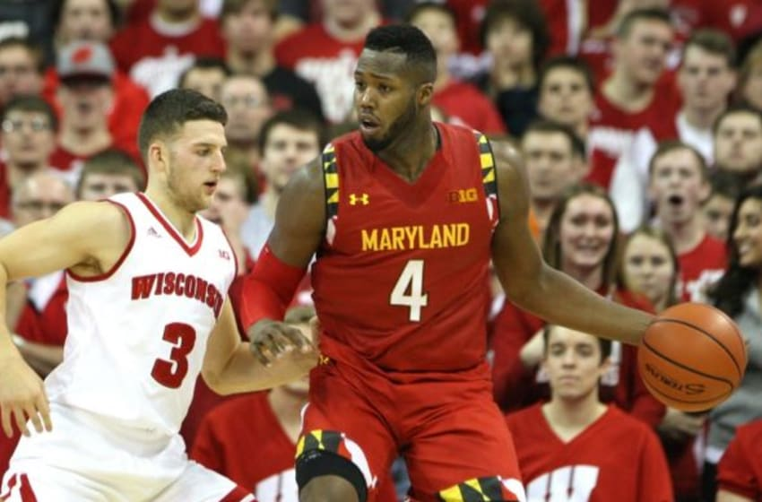 Jan 9, 2016; Madison, WI, USA; Maryland Terrapins forward Robert Carter (4) works the ball against Wisconsin Badgers guard Zak Showalter (3) at the Kohl Center. Maryland defeated Wisconsin 63-60. Mandatory Credit: Mary Langenfeld-USA TODAY Sports