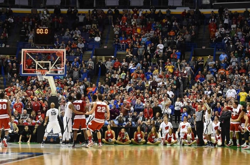 Mar 20, 2016; St. Louis, MO, USA; Wisconsin Badgers guard Bronson Koenig (24) shoots the game-winning shot during the second half in the second round against the Xavier Musketeers of the 2016 NCAA Tournament at Scottrade Center. Wisconsin won 66-63. Mandatory Credit: Jasen Vinlove-USA TODAY Sports