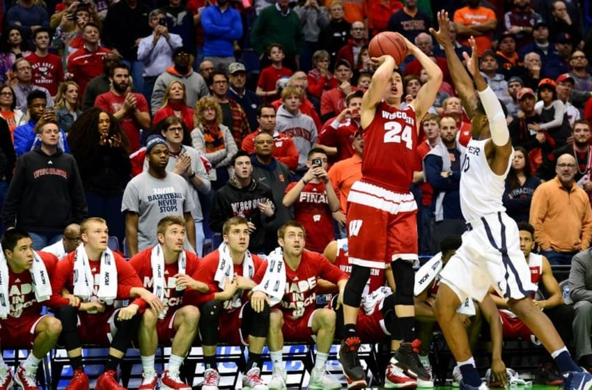 Mar 20, 2016; St. Louis, MO, USA; Wisconsin Badgers guard Bronson Koenig (24) shoots the game-winning shot over Xavier Musketeers guard Remy Abell (10) during the second half of the second round in the 2016 NCAA Tournament at Scottrade Center. Wisconsin won 66-63. Mandatory Credit: Jeff Curry-USA TODAY Sports