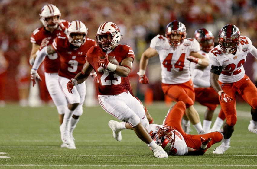 MADISON, WI - AUGUST 31: Jonathan Taylor #23 of the Wisconsin Badgers breaks a tackle attempt by Kyle Bailey #36 of the Western Kentucky Hilltoppers in the first quarter at Camp Randall Stadium on August 31, 2018 in Madison, Wisconsin. (Photo by Dylan Buell/Getty Images)