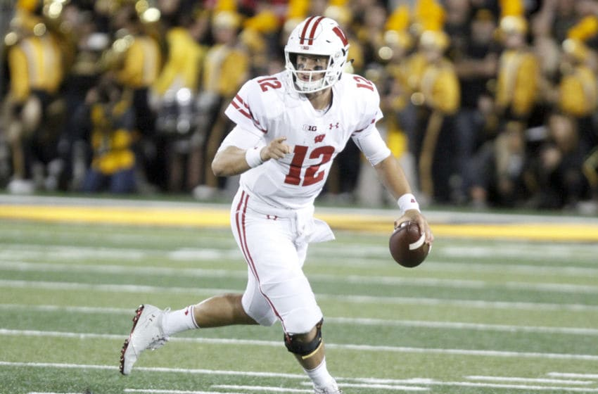 IOWA CITY, IOWA- SEPTEMBER 22: Quarterback Alex Hornibrook #12 of the Wisconsin Badgers scrambles on a keeper in the first half against the Iowa Hawkeyes on September 22, 2018 at Kinnick Stadium, in Iowa City, Iowa. (Photo by Matthew Holst/Getty Images)