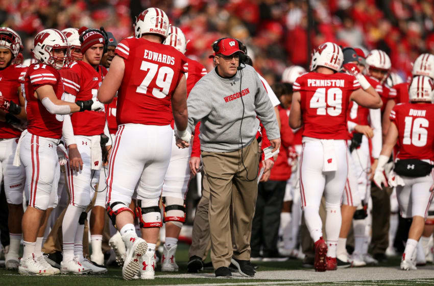 MADISON, WISCONSIN - NOVEMBER 03: Head coach Paul Chryst of the Wisconsin Badgers celebrates with David Edwards #79 after scoring a touchdown in the first quarter against the Rutgers Scarlet Knights at Camp Randall Stadium on November 03, 2018 in Madison, Wisconsin. (Photo by Dylan Buell/Getty Images)