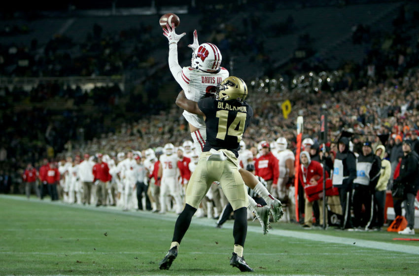 WEST LAFAYETTE, INDIANA - NOVEMBER 17: Danny Davis III #6 of the Wisconsin Badgers makes a catch to score a touchdown past Antonio Blackmon #14 of the Purdue Boilermakers in the fourth quarter at Ross-Ade Stadium on November 17, 2018 in West Lafayette, Indiana. (Photo by Dylan Buell/Getty Images)