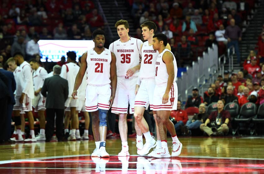 MADISON, WISCONSIN - DECEMBER 22: Khalil Iverson #21, Nate Reuvers #35, Ethan Happ #22 and D'Mitrik Trice #0 of the Wisconsin Badgers walk onto the court to start the second half against the Grambling State Tigers at Kohl Center on December 22, 2018 in Madison, Wisconsin. (Photo by Stacy Revere/Getty Images)
