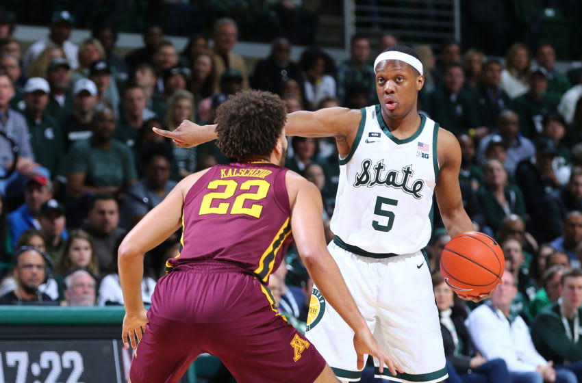 EAST LANSING, MI - FEBRUARY 09: Cassius Winston #5 of the Michigan State Spartans directs play while defended by Gabe Kalscheur #22 of the Minnesota Golden Gophers in the first half at Breslin Center on February 9, 2019 in East Lansing, Michigan. (Photo by Rey Del Rio/Getty Images)