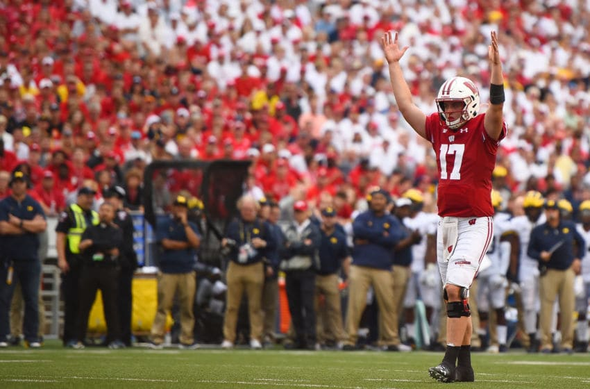 MADISON, WISCONSIN - SEPTEMBER 21: Jack Coan #17 of the Wisconsin Badgers celebrates a touchdown during the second half of a game against the Michigan Wolverines at Camp Randall Stadium on September 21, 2019 in Madison, Wisconsin. (Photo by Stacy Revere/Getty Images)