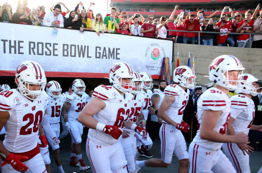PASADENA, CALIFORNIA - JANUARY 01: The Wisconsin Badgers run out of the tunnel prior to the Rose Bowl game presented by Northwestern Mutual against the Oregon Ducks at Rose Bowl on January 01, 2020 in Pasadena, California. (Photo by Joe Scarnici/Getty Images)