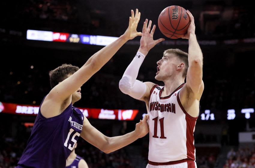 MADISON, WISCONSIN - MARCH 04: Micah Potter #11 of the Wisconsin Badgers attempts a shot while being guarded by Ryan Young #15 of the Northwestern Wildcats in the second half at the Kohl Center on March 04, 2020 in Madison, Wisconsin. (Photo by Dylan Buell/Getty Images)