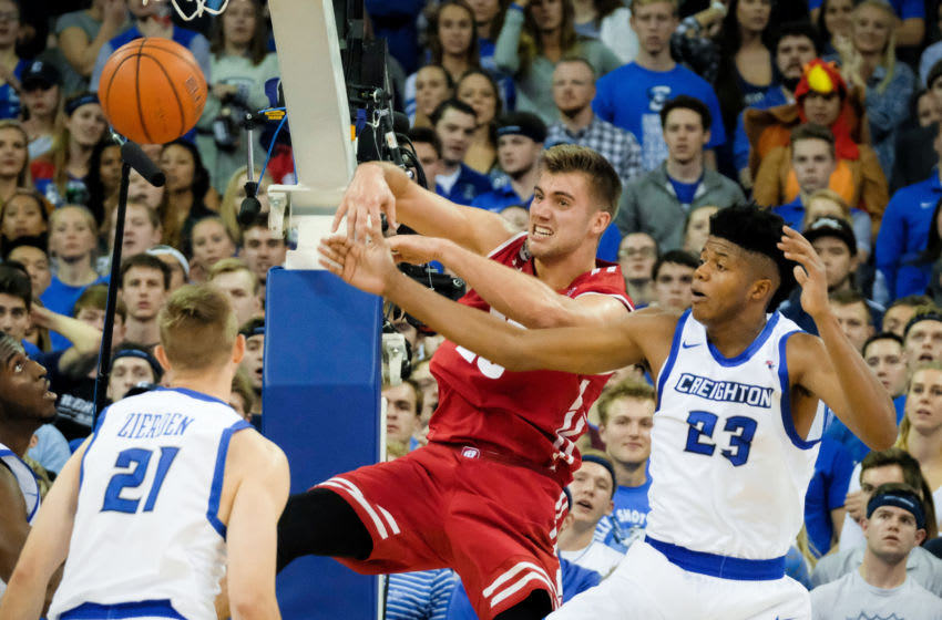 OMAHA, NE - NOVEMBER 15: Alex Illikainen #25 of the Wisconsin Badgers passes around Justin Patton #23 of the Creighton Bluejays during their game at the CenturyLink Center on November 15, 2016 in Omaha, Nebraska. (Photo by Eric Francis/Getty Images)