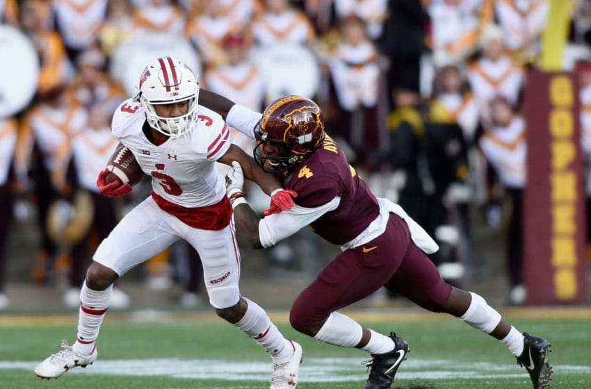 MINNEAPOLIS, MN - NOVEMBER 25: Adekunle Ayinde #4 of the Minnesota Golden Gophers tackles Kendric Pryor #3 of the Wisconsin Badgers during the first quarter of the game on November 25, 2017 at TCF Bank Stadium in Minneapolis, Minnesota. (Photo by Hannah Foslien/Getty Images)