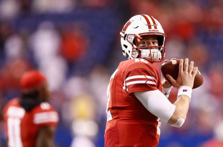 INDIANAPOLIS, IN - DECEMBER 02: Quarterback Alex Hornibrook #12 of the Wisconsin Badgers throws a pass while warming up before playing against the Ohio State Buckeyes at Lucas Oil Stadium on December 2, 2017 in Indianapolis, Indiana. (Photo by Andy Lyons/Getty Images)