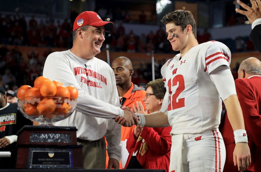 MIAMI GARDENS, FL - DECEMBER 30: Head coach Paul Chryst and Alex Hornibrook #12 of the Wisconsin Badgers celebrates after winning the 2017 Capital One Orange Bowl against the Miami Hurricanes at Hard Rock Stadium on December 30, 2017 in Miami Gardens, Florida. (Photo by Mike Ehrmann/Getty Images)