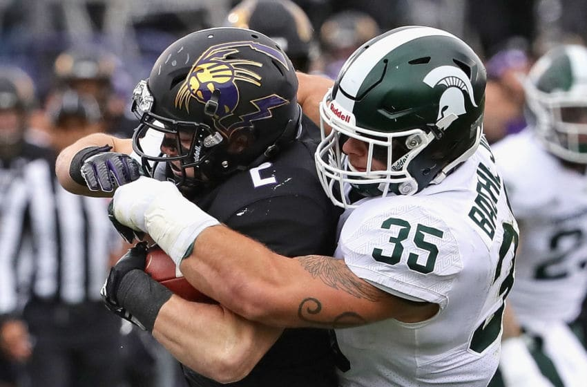 EVANSTON, IL - OCTOBER 28: Joe Bachie #35 of the Michigan State Spartans tackles Flynn Nagel #2 of the Northwestern Wildcats at Ryan Field on October 28, 2017 in Evanston, Illinois. Northwestern defeated Michigan State 39-31 in triple overtime. (Photo by Jonathan Daniel/Getty Images)
