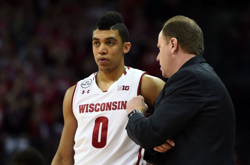 MADISON, WI - FEBRUARY 12: Head coach Greg Gard of the Wisconsin Badgers speaks with D'Mitrik Trice