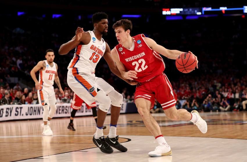 NEW YORK, NY - MARCH 24: Ethan Happ #22 of the Wisconsin Badgers drives to the basket against Kevarrius Hayes #13 of the Florida Gators during the 2017 NCAA Men's Basketball Tournament East Regional at Madison Square Garden on March 24, 2017 in New York City. (Photo by Maddie Meyer/Getty Images)