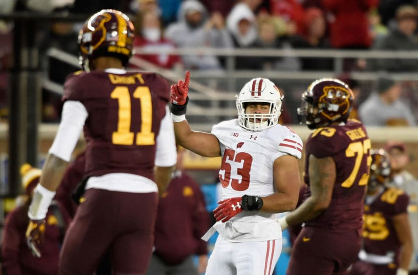MINNEAPOLIS, MN - NOVEMBER 25: T.J. Edwards #53 of the Wisconsin Badgers celebrates a tackle on third down as quarterback Demry Croft #11 and Donnell Greene #73 of the Minnesota Golden Gophers head back to the bench during the third quarter of the game on November 25, 2017 at TCF Bank Stadium in Minneapolis, Minnesota. The Badgers defeated the Golden Gophers 31-0. (Photo by Hannah Foslien/Getty Images)
