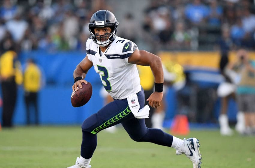CARSON, CA - AUGUST 18: Russell Wilson #3 of the Seattle Seahawks scrambles out of the pocket during the first quarter of a presseason game against the Los Angeles Chargers at StubHub Center on August 18, 2018 in Carson, California. (Photo by Harry How/Getty Images)