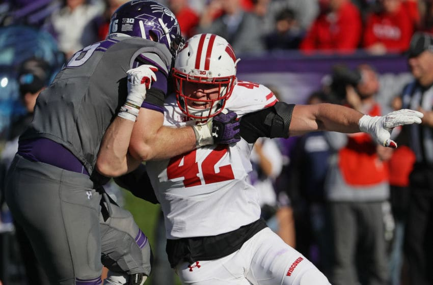 EVANSTON, IL - NOVEMBER 05: T.J. Watt #42 of the Wisconsin Badgers rushes against Eric Olson #76 of the Northwestern Wildcats at Ryan Field on November 5, 2016 in Evanston, Illinois. Wisconsin defeated Northwestern 21-7. (Photo by Jonathan Daniel/Getty Images)