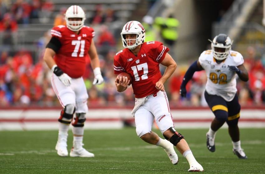 MADISON, WISCONSIN - OCTOBER 05: Jack Coan #17 of the Wisconsin Badgers runs for yards during the first half against the Kent State Golden Flashes at Camp Randall Stadium on October 05, 2019 in Madison, Wisconsin. (Photo by Stacy Revere/Getty Images)