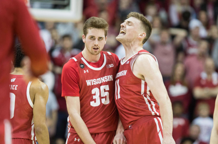 Mar 7, 2020; Bloomington, Indiana, USA; Wisconsin Badgers forward Nate Reuvers (35) and forward Micah Potter (11) celebrate during a timeout in the second half against the Indiana Hoosiers at Simon Skjodt Assembly Hall. Mandatory Credit: Trevor Ruszkowski-USA TODAY Sports