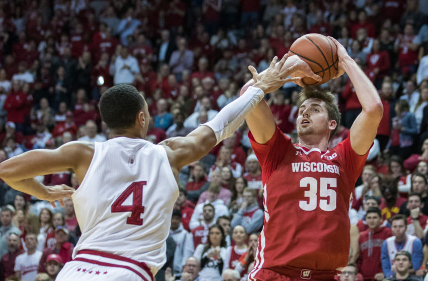 Mar 7, 2020; Bloomington, Indiana, USA; Wisconsin Badgers forward Nate Reuvers (35) shoots the ball over Indiana Hoosiers forward Trayce Jackson-Davis (4) in the second half at Simon Skjodt Assembly Hall. Mandatory Credit: Trevor Ruszkowski-USA TODAY Sports