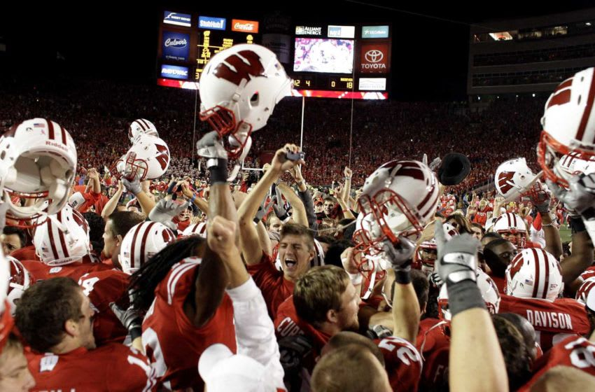 Students and Badger fans rush the field after the University of Wisconsin upset the number 1 ranked Ohio State Buckeyes at Camp Randall Stadium 31-18 in Madison WI Saturday October 16, 2010. Uwgrid17 Spt Lynn 17