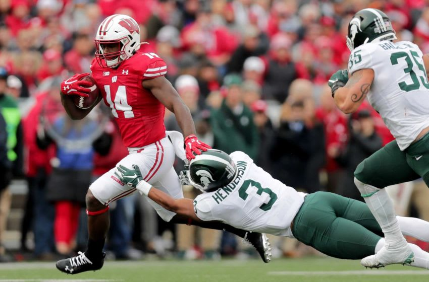 Badgers running back Nakia Watson pushes Michigan State safety Xavier Henderson aside on 19-yard run in the first half. Ncaa Football Michigan State At Wisconsin. Credit: Mike De Sisti, Milwaukee Journal Sentinel-Imagn Content Services, LLC Syndication: Milwaukee