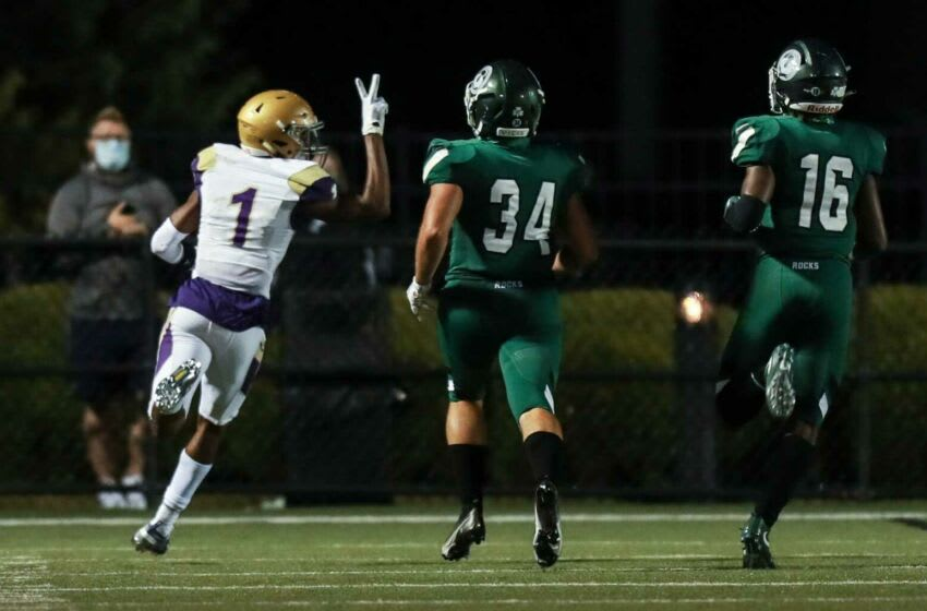 Male's Vinny Anthony holds up two fingers as he beats two Shamrock defenders while scoring on a 60-plus yard touchdown against Trinity Friday evening. Sept. 18, 2020 Trinity Vs Male September 2020