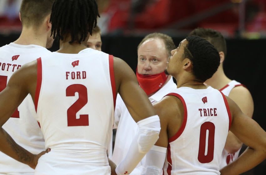 Dec 9, 2020; Madison, Wisconsin, USA; Wisconsin Badgers head coach Greg Gard talks with his team during a huddle during the game with the Rhode Island Rams at the Kohl Center. Mandatory Credit: Mary Langenfeld-USA TODAY Sports