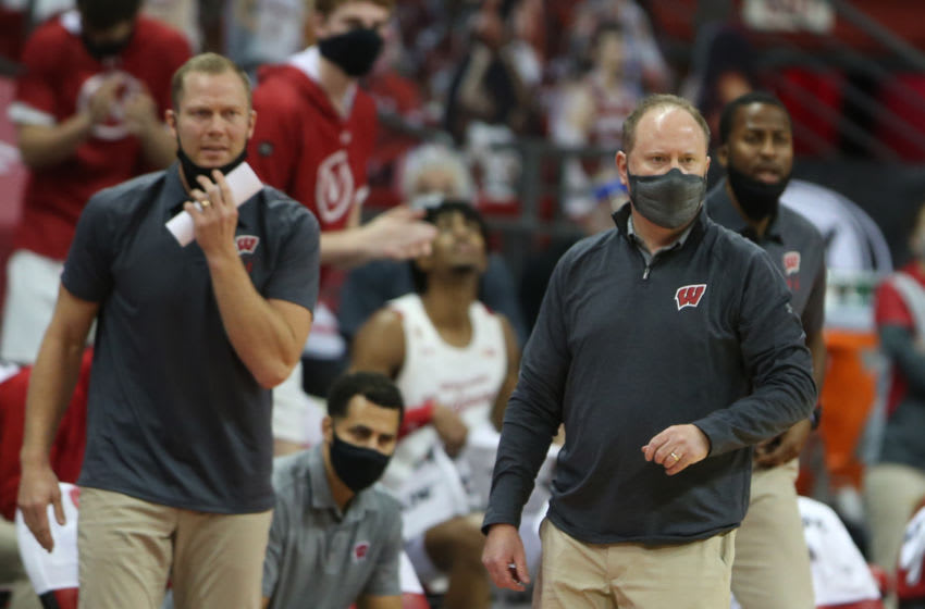 Dec 22, 2020; Madison, Wisconsin, USA; Wisconsin Badgers head coach Greg Gard and his assistant coaches watch their team during the game with the Nebraska Cornhuskers in the second half at the Kohl Center. Mandatory Credit: Mary Langenfeld-USA TODAY Sports