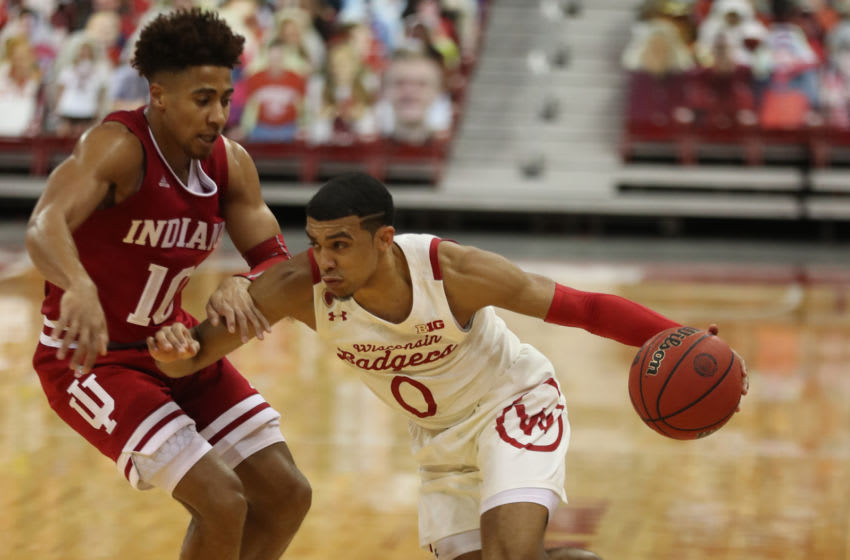 Jan 7, 2021; Madison, Wisconsin, USA; Wisconsin Badgers guard D'Mitrik Trice (0) dribbles the ball past Indiana Hoosiers guard Rob Phinisee (10) during the first half at the Kohl Center. Mandatory Credit: Mary Langenfeld-USA TODAY Sports