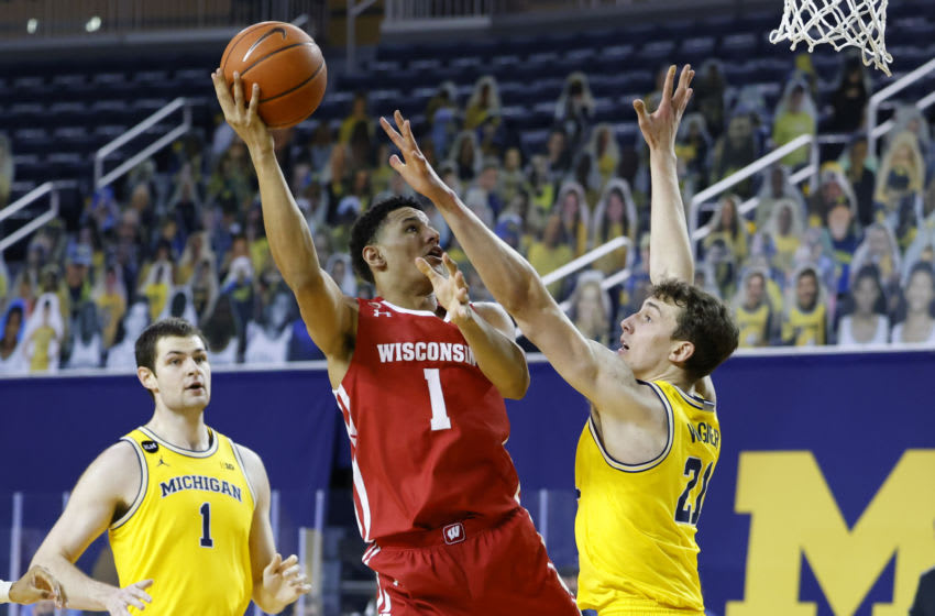 Jan 12, 2021; Ann Arbor, Michigan, USA; Wisconsin Badgers guard Jonathan Davis (1) shoots against Michigan Wolverines guard Franz Wagner (21) in the second half at Crisler Center. Mandatory Credit: Rick Osentoski-USA TODAY Sports
