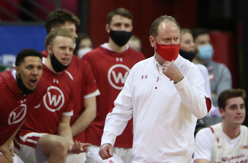 Feb 14, 2021; Madison, Wisconsin, USA; Wisconsin Badgers head coach Greg Gard watches his team in the game with the Michigan Wolverines during the second half at the Kohl Center. Mandatory Credit: Mary Langenfeld-USA TODAY Sports