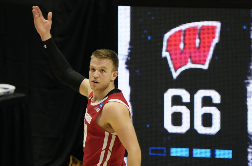 Mar 19, 2021; West Lafayette, Indiana, USA; Wisconsin Badgers guard Brad Davison (34) reacts after a basket against the North Carolina Tar Heels during the second half in the first round of the 2021 NCAA Tournament at Mackey Arena. Mandatory Credit: Mike Dinovo-USA TODAY Sports