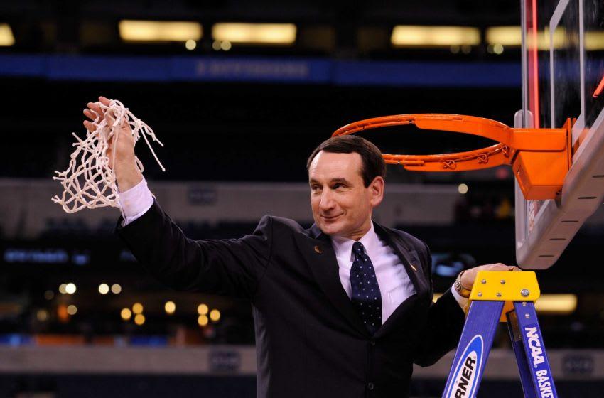 Duke head coach Mike Krzyzewski cuts down the nets at the 2010 NCAA men's Final Four national basketball championship after Duke beat Butler 61-59. Xxx Final Four Rd624 Jpg S Bkc Usa In