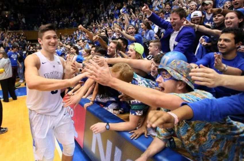 Feb 13, 2016; Durham, NC, USA; Duke Blue Devils guard Grayson Allen (3) celebrates with the Cameron Crazies after making the game winning basket in the second half of their game against the Virginia Cavaliers to win 63-62 at Cameron Indoor Stadium. Mandatory Credit: Mark Dolejs-USA TODAY Sports
