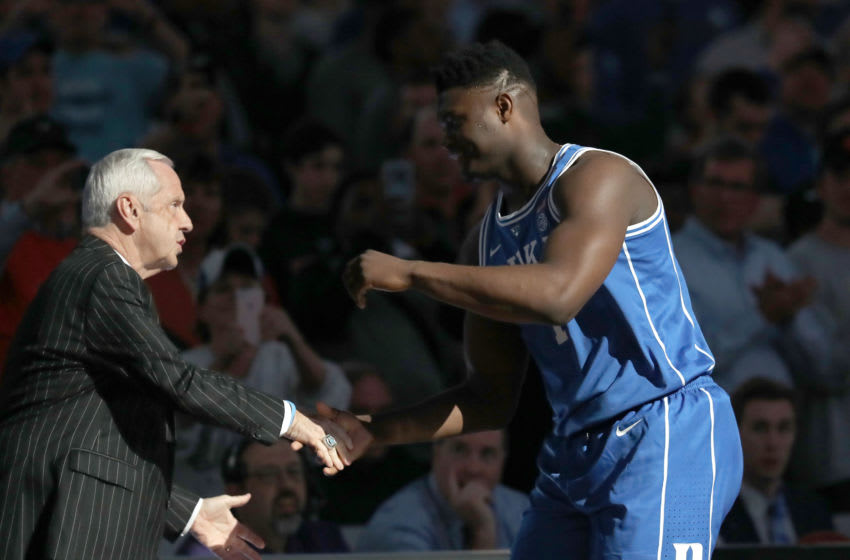 Duke basketball forward Zion Williamson and UNC head coach Roy Williams (Photo by Streeter Lecka/Getty Images)