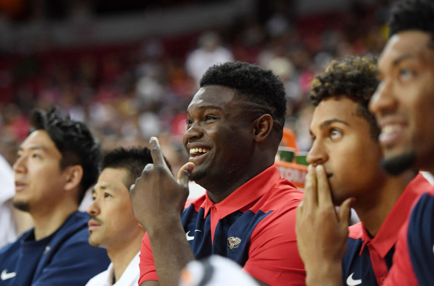 LAS VEGAS, NEVADA - JULY 06: Zion Williamson (C) #1 of the New Orleans Pelicans looks on from the bench as his team takes on the Washington Wizards during the 2019 NBA Summer League at the Thomas & Mack Center on July 6, 2019 in Las Vegas, Nevada. NOTE TO USER: User expressly acknowledges and agrees that, by downloading and or using this photograph, User is consenting to the terms and conditions of the Getty Images License Agreement. (Photo by Ethan Miller/Getty Images)