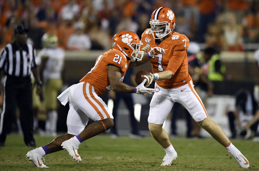 Duke football transfer quarterback hands the ball off for the Clemson Tigers in 2019.