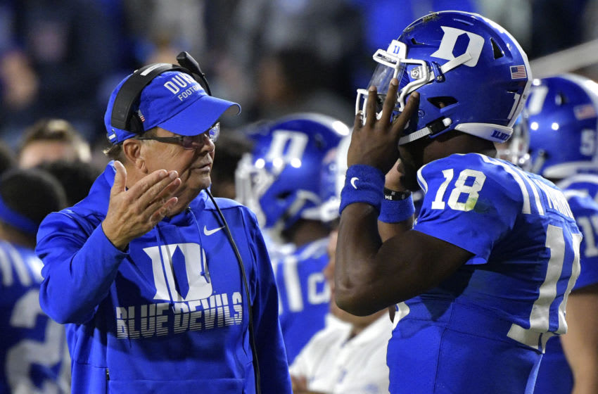 Duke football head coach David Cutcliffe talks with quarterback Quentin Harris. (Photo by Grant Halverson/Getty Images)
