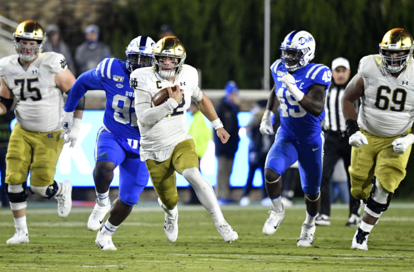 Duke football defenders try and tackle Ian Book. (Photo by Grant Halverson/Getty Images)