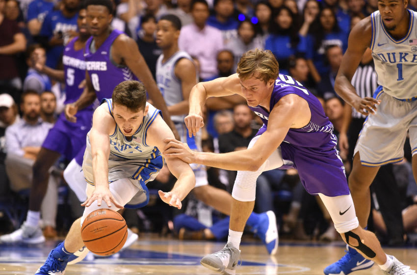 Duke basketball freshman Matthew Hurt #21 of the Duke Blue Devils battles Hayden Koval #15 of the Central Arkansas Bears for a loose ball during the first half of their game at Cameron Indoor Stadium on November 12, 2019, in Durham, North Carolina. (Photo by Grant Halverson/Getty Images)