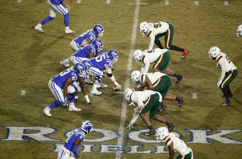 DURHAM, NC - NOVEMBER 30: Duke football players face off at the line of scrimmage against the Miami Hurricanes during a game at Wallace Wade Stadium on November 30, 2019 in Durham, North Carolina. Duke defeated Miami 27-17. (Photo by Joe Robbins/Getty Images)