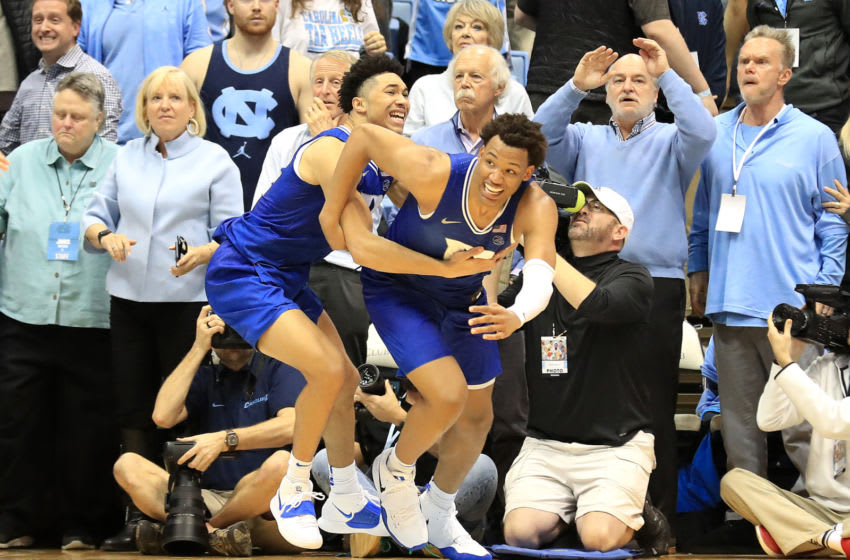 Duke basketball guard Jordan Goldwire and forward Wendell Moore celebrate a win at North Carolina (Photo by Streeter Lecka/Getty Images)