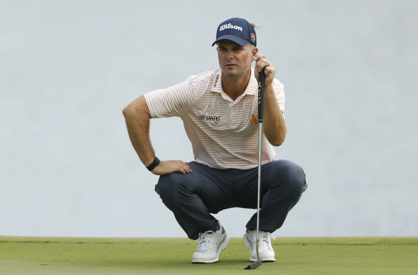 Former Duke golf standout Kevin Streelman looks at an upcoming putt. (Photo by Michael Reaves/Getty Images)