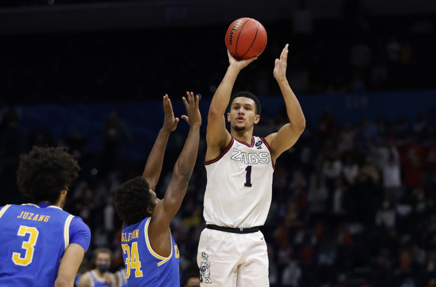 Jalen Suggs' buzzer beater compared to iconic Duke basketball shot (Photo by Jamie Squire/Getty Images)